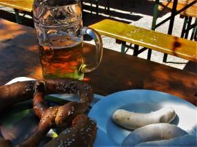 Beer, weisswurst and pretzel make a typical Munich breakfast.