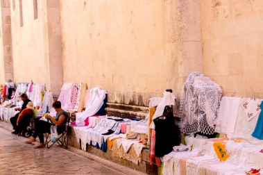 Selling embroidered products next to the cathedral